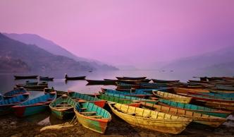 Beautiful twilight landscape with boats on Phewa lake