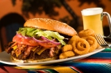 Giant Bacon Cheese Burger with Onion Rings and Beer