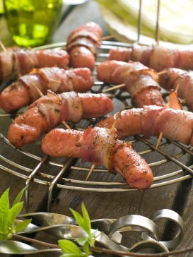 Grilled sausage wrapped in bacon