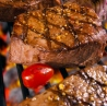 Grilled Cherry Tomatoes keep a good amount of moisture near steaks