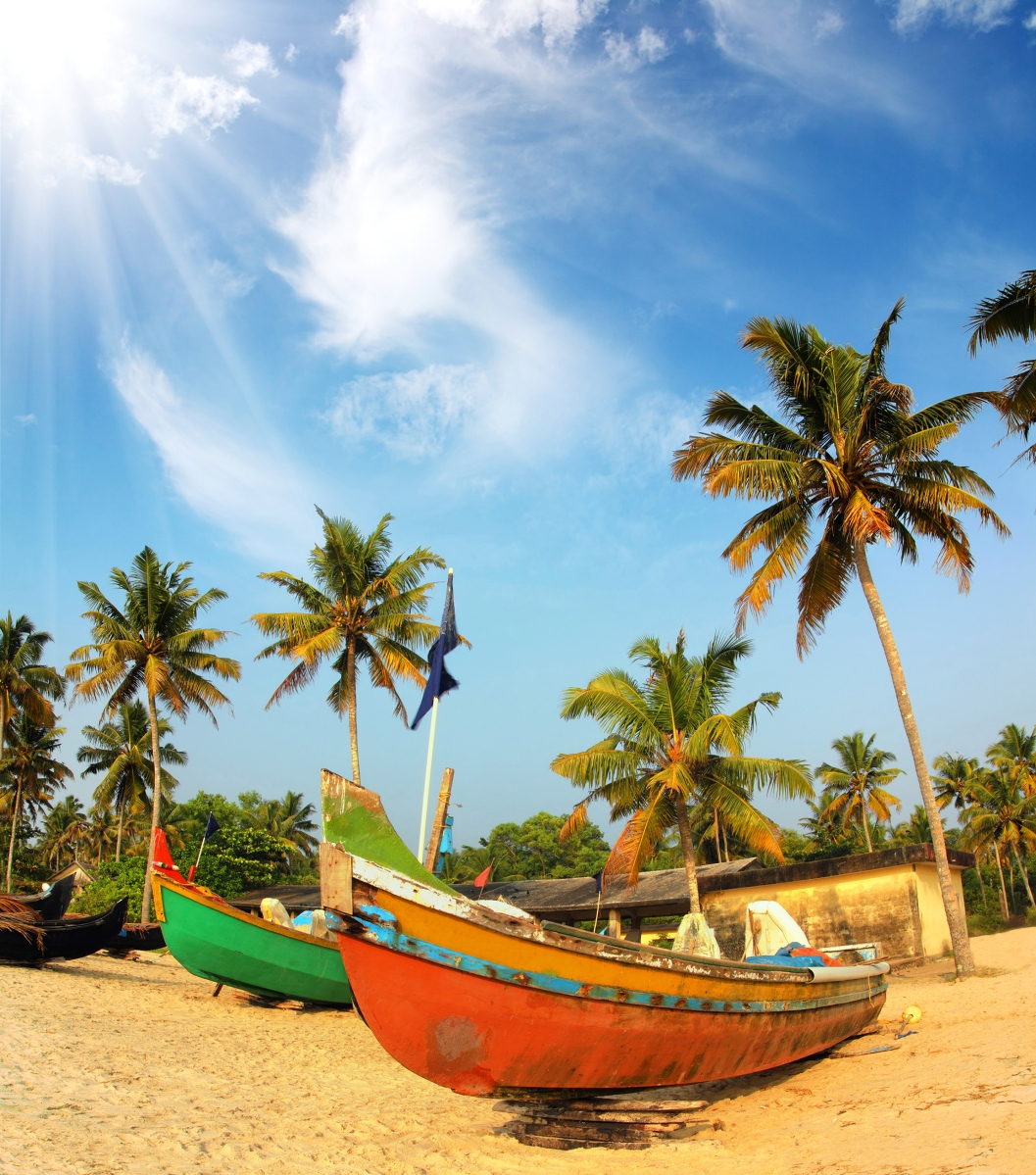 old fishing boats on beach in Kerala