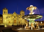 A fountain in Plaza de Armas with Cathedral,Night view