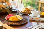 Delicious healthy breakfast with fruit selection and coffee Room Service