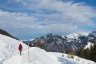 Female Hiker in snow covered mountains