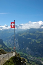 Swiss Flag flying over Alps